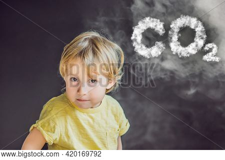 Boy Turns His Face Away From The Cigarette Smoke Co2 Lettering Made Of Clouds Isolated On Black. Sky