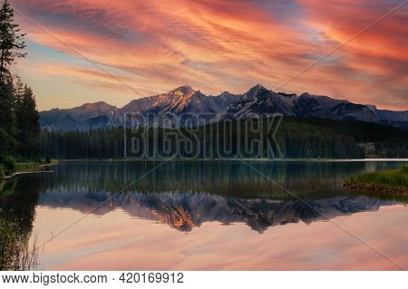 Golden Sunset At Two Jack Lake Campground In The Canadian Rockies Of Banff National Park.