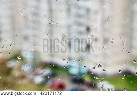The Texture Of Raindrops On The Window In The Daytime. Close-up Of Raindrops On The Glass. Rainy Bac