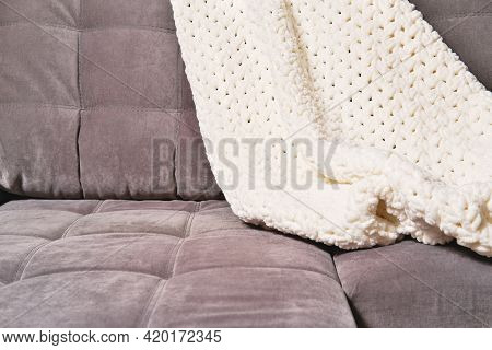 Cozy Plaid Or Knitted Blanket On A Modern Sofa. Cosy Home Concept. Relaxing Me-time, Calm Place To G