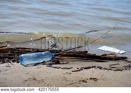 Seashore Contaminated With Plastic And Other Debris. Global Problems Of Environmental Pollution