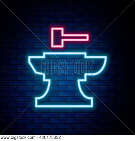 Glowing Neon Line Anvil For Blacksmithing And Hammer Icon Isolated On Brick Wall Background. Metal F