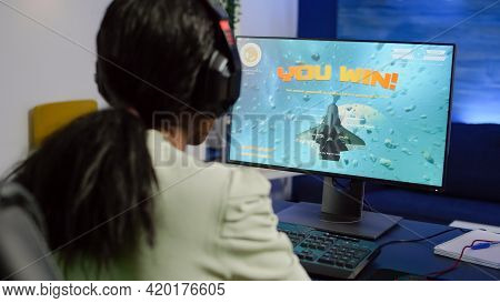 African Streamer Woman Winning Space Shooter Video Game