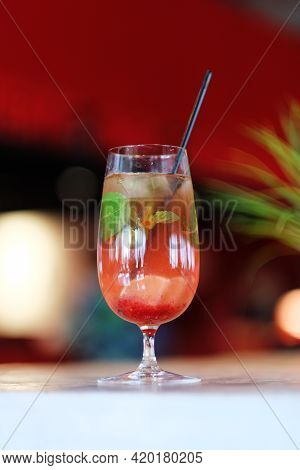 Fresh Cocktail With Lime, Mint, Raspberries And Ice. Alcoholic, Non-alcoholic Drink-a Drink At The B