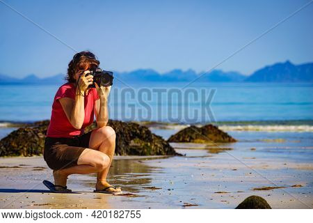 Tourist Woman Relaxing Walking On Sea Shore With Camera, Taking Travel Photos. Coast Of Gimsoya Isla