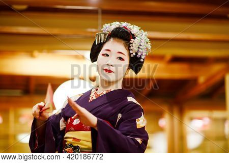 Kyoto, Japan - 18 May, 2015: Maiko Apprentice Showing Japanese Traditional Dance. Maiko Is An Appren