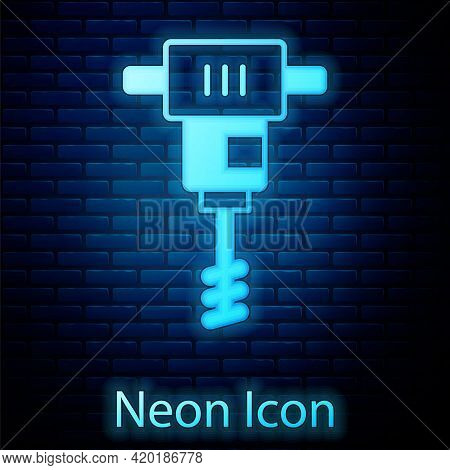 Glowing Neon Electrical Hand Concrete Mixer Icon Isolated On Brick Wall Background. Handheld Electri