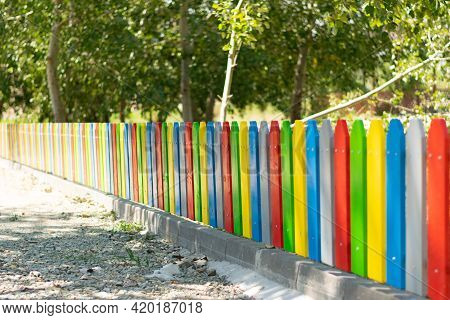 Colorfull Painted Wood Fence With Shallow Dof