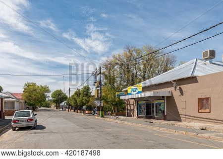 Richmond, South Africa - April 2, 2021: A Street Scene, With A Business, A Car And People, In Richmo