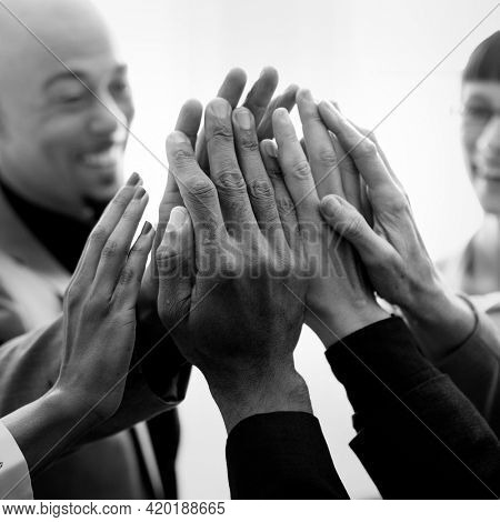 Cheerful business people doing a high five