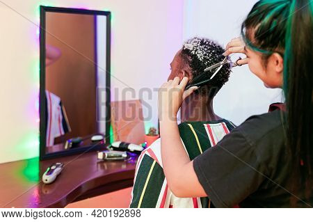 Young Asian Woman Barber  Cuting Black An White Hair Customer. Beautiful Hairstylist Trimming Scisso