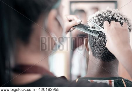 Female Hairdresser With Face Mask Protect Working In Barber Shop. Beauty, Hairstyle And People Conce