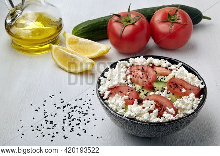 Chopped Tomatoes And Cucumbers With Cottage Cheese And Black Cumin Seeds