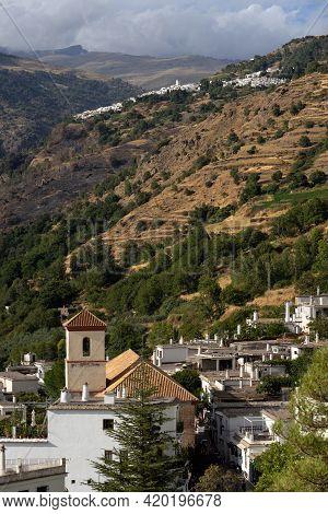 Capileira, Granada - September 01, 2020: View Of The White Village Of Pampaneira In The Alpujarra Re