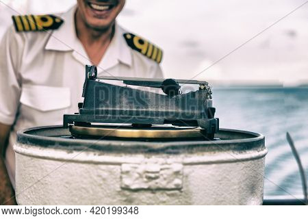Cruise ship magnetic compass navigational equipment onboard on deck for direction of heading of the vessel, the ship's head.