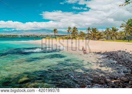 Hawaii beach travel landscape. Summer vacation hero view of woman tourist walking on secluded bay in Waikoloa, Big Island, HAWAII, USA destination.