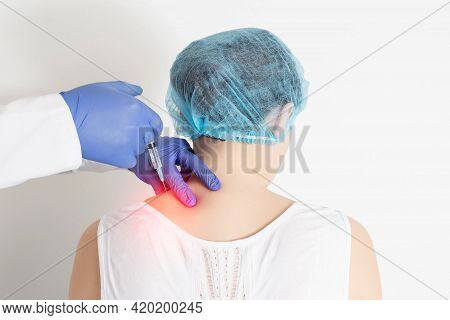 The Doctor Makes An Injection Medical Blockade Into The Paravertebral Tissue To Relieve Pain And Pin