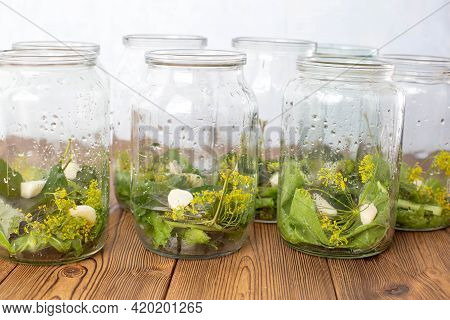 Jars With Spices, Garlic And Pickle For Preserving Cucumbers. Jars With Spices On A Wooden Backgroun