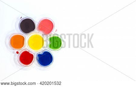 Multicolored Water Paints Kids Finger Paints In Plastic Containers On A White Background, Drawing Ho