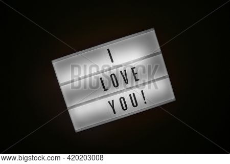 Lightbox With Message I Love You Isolated On Black Background. Inscription Glows In Dark. Concept Of