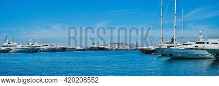 Panorama of moored Yachts and boats on summer day in port of Athens. Athens, Greece