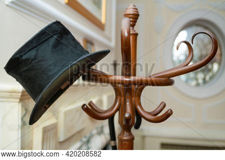 Party Invitation Concept Top Hat and Umbrella on a Coat Stand
