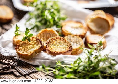 Crispy Goldish Bake Rolls With Savory Flavour, Served With Lovely Green Thyme.