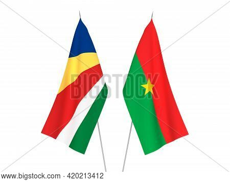 National Fabric Flags Of Seychelles And Burkina Faso Isolated On White Background. 3d Rendering Illu