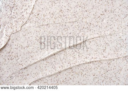 Texture Of Organic White Scrub With Exfoliating Coffee Particles. Close-up
