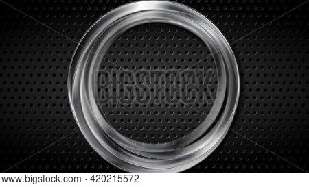 Silver metallic ring on black perforated background