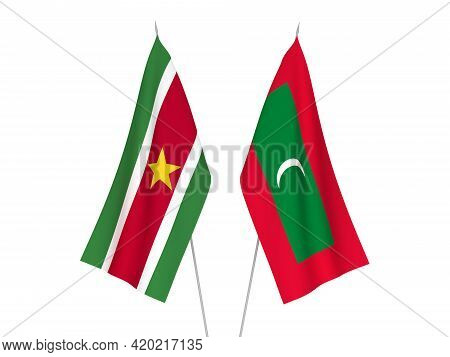National Fabric Flags Of Maldives And Suriname Isolated On White Background. 3d Rendering Illustrati