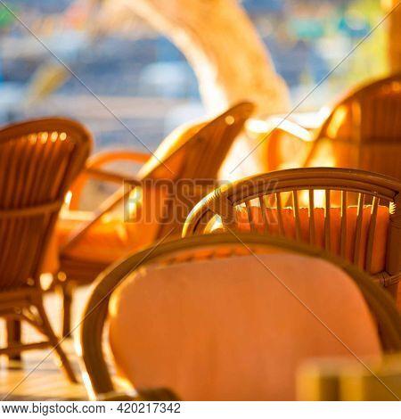 Outdoor cafes in coastline resort Kamari in Santorini Greece