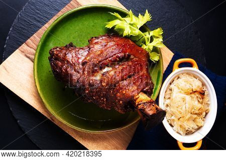 Food Concept German Pork Hock Or Pork Knuckle With Sauerkraut Cabbage Pickle On Wooden Board With Co