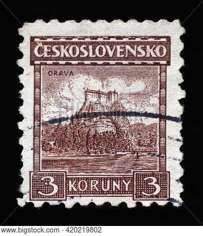 ZAGREB, CROATIA - SEPTEMBER 18, 2014: Stamp printed in Czechoslovakia shows Orava Castle - the major landmark in the Orava region, Slovakia, circa 1931