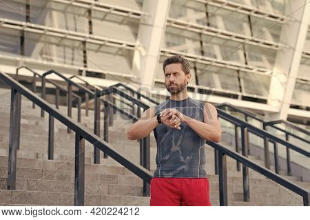 Great Progress. Staying Fit And Healthy. Checking His Watch While Jogging In The Morning. Running Ma