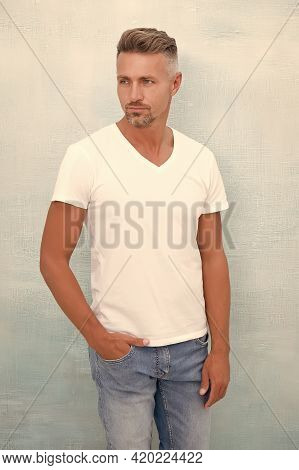 Menswear Concept. Handsome Hipster Wear White Shirt. Summer Collection. Fashion Clothes. Simple And