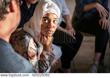 People listening to a speaker in a rehab session