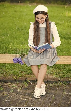 Reading Development. Little Child Read Book On Park Bench. Child Development. Learning And Mastering