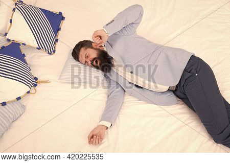Business Never Sleeps. Bearded Man Yawn In Business Suit. Hipster Lying In Bed. Business Elegant Att