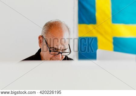 Swedish elderly man at a polling booth