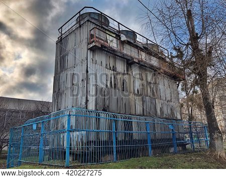 Industry. Side View Of The Water Tower. Water Tower, Water Station. Storage And Provision Of Water S