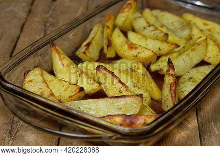Fried Potato Wedges. Homemade Fried Food. Fried Vegetables. Tasty Food.