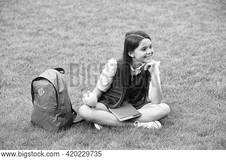 Your Health Is Your Wealth. Happy Child Relax On Green Grass. Healthy Snack. School Break. Health Ed