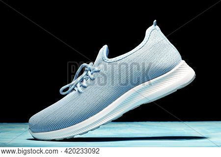 Womens Textile Sneaker Casts A Shadow In Motion. Movement And Lightness Concept