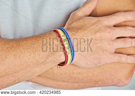 Male Crossed Arms With Rainbow Bracelet And Text Pride Lgbtq