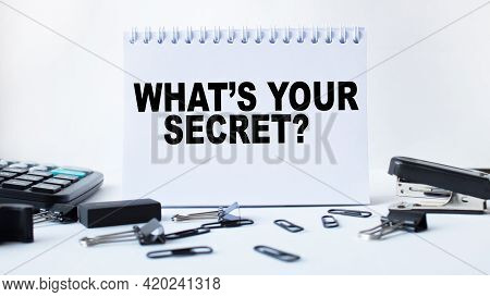 Notepad With Text What's Your Secret On The Office Desk With Stationery. A Blank Notepad For Enterin