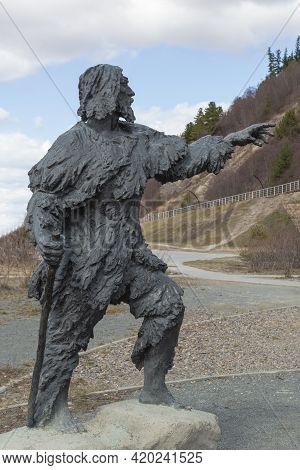 Statue Of Primitive Man. Khanty-mansiysk City, Russia - May 3, 2021