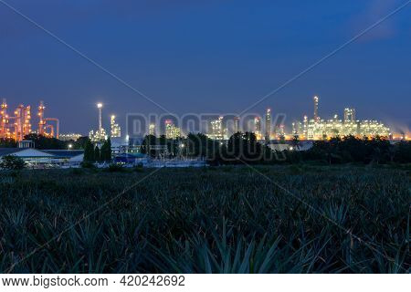 Industrial Plant At Twilight. Petrochemical Oil Refinery Factory Plant.