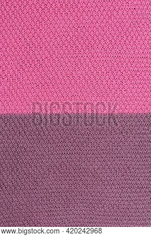 Pink And Brown Knitted Fabric Pearl Woolen Background. The Structure Of The Fabric With A Natural Te