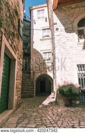Narrow Street And Residential Buildings In The Town Of Trogir, Dalmatia Region, Croatia.